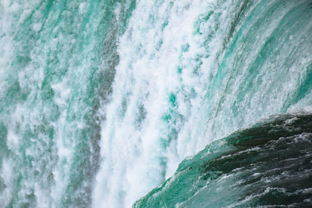 Closeup on water rushing from Niagara Falls waterfall